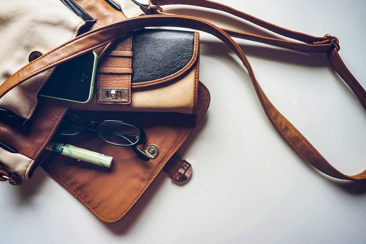 A pile of good quality goods, a purse, a pen, glasses.